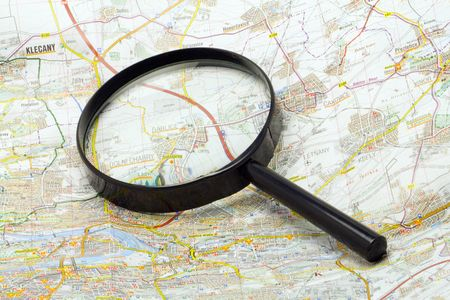 multiplying: magnifying glass on a map - close-up