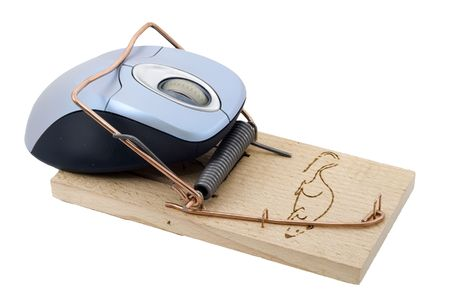 trickery: a computer mouse caught in a mousetrap