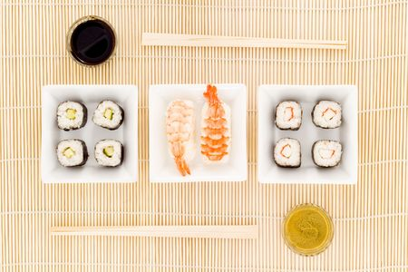 soysauce: a plate with different kinds of sushi