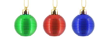 trio christmas ornaments in blue, red and green - close up photo
