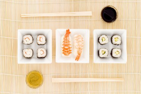 a plate with different kinds of sushi photo