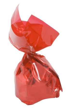 a piece of sweets in a red wrapper - confectionery - close up