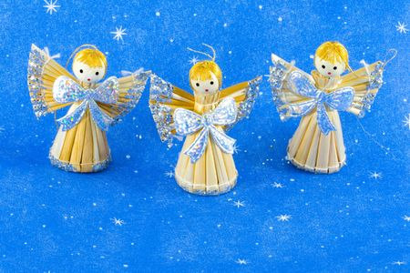 three straw christmas angels - seasonal decoration - close up photo