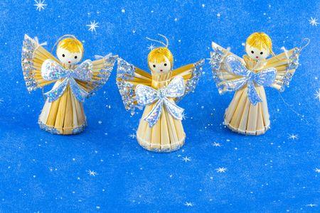 three straw christmas angels - seasonal decoration - close up