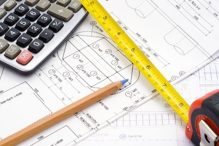 a technical design with a pencil, a calculator and a measure tape