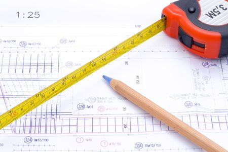 a technical design with a pencil and a measure tape Stock Photo