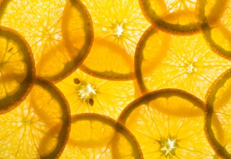 backlit pieces of sliced orange - healthy eating photo