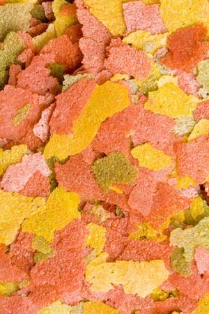aquarist: A close-up of a lot of dry goldfish food Stock Photo