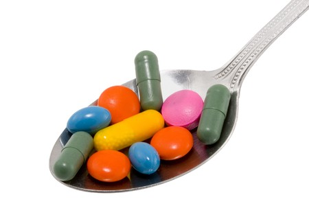 a spoon full of different kinds of drugs photo