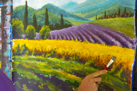 Painter artist draw with brush French summer Lavender rural landscape. French Tuscany. Field of red poppies, a field of yellow rye.