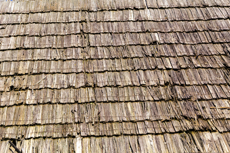 Old rotten wooden textured roof of the house for the background, wallpaper, screen savers