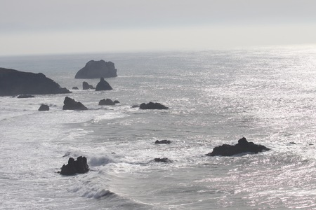 Sonoma Coast State Park -  northwestern Sonoma County, California,  is the mouth of the Russian River, and the southern end of this crescent shaped expanse is the massive Goat. January. Stock Photo