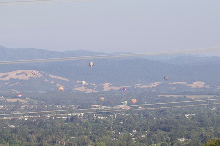 Shiloh Ranch Regional California airballoons.  The park includes oak woodlands, forests of mixed evergreens, ridges with sweeping views of the Santa Rosa Plain, canyons, rolling hills, a shaded creek, and a pond.