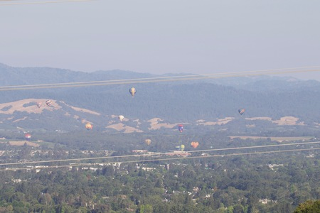 Shiloh Ranch Regional California air balloons.  The park includes oak woodlands, forests of mixed evergreens, ridges with sweeping views of the Santa Rosa Plain, canyons, rolling hills, a shaded creek, and a pond.