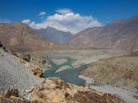 Confluence of Indus and Gilgit Rivers in Northern area of Pakistan Where Karakoram, Hindukush And Himalayan Ranges Meet Stock Photo