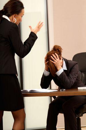 ashamed: Business woman discussing a failure