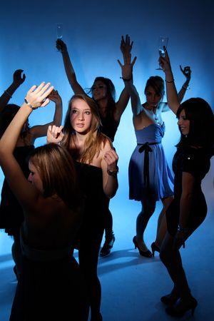 Dancing girls with hands up Standard-Bild