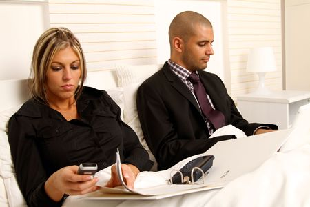 workaholic: Workaholic couple in bedroom