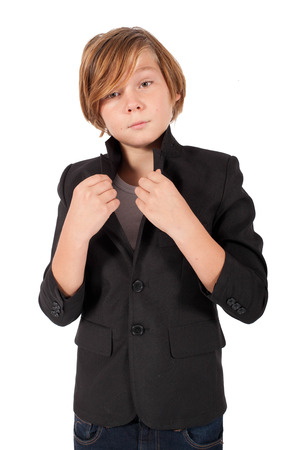 arrogant teen: blonde boy in a black jacket Stock Photo