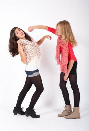 argumentative: two grild pretend to have a fistfight