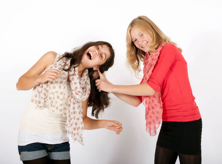 argumentative: young girls pulling each others hair