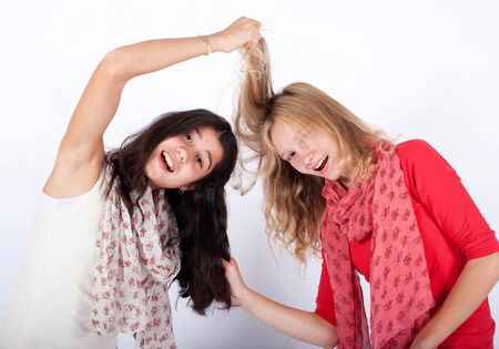 two girls pulling each others hair