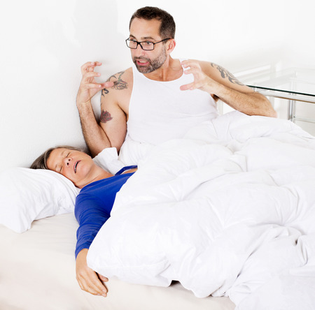 woman sleeping and man being upset