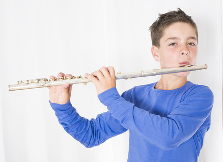 flute instrument: portrait of a boy playing the flute