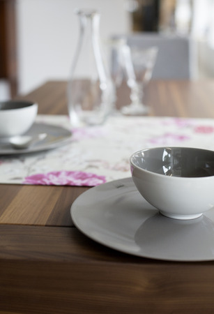 interior accessories: closeup of cup and plate on wooden table