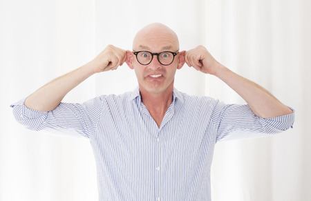 portrait of a bald-headed man making a grimace photo