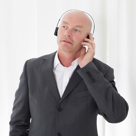 bald-headed businessman with headphones photo