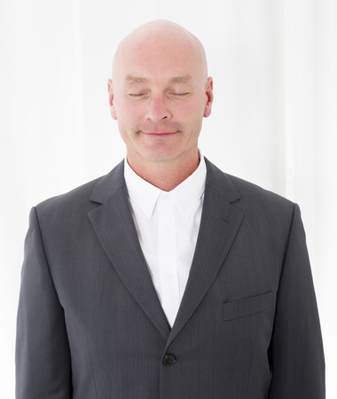 face centered: portrait of a businessman with his eyes closed Stock Photo