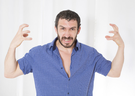 aggresive: bearded man looks very upset with his hands up