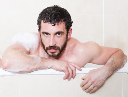 latin man relaxes in a bathtub photo