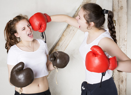 two young girls dressed as boxers are fighting photo