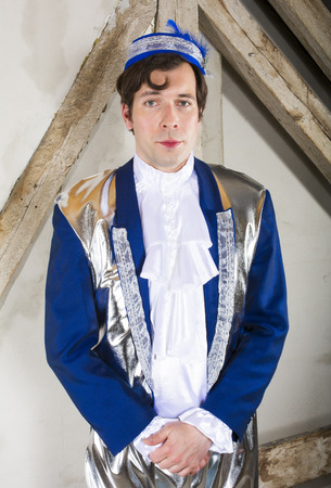 man dressed as a prince with a blue hat