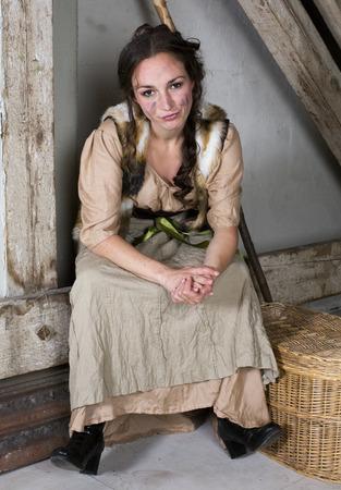 brunette woman dressed as cinderella looking upset photo