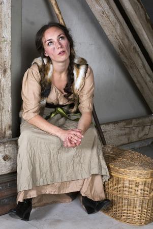 cinderella: brunette woman dressed as cinderella looking upset Stock Photo