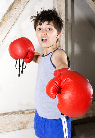 young boy with red boxing gloves photo