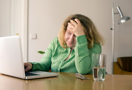 obese woman: young woman sitting on a desk with laptop