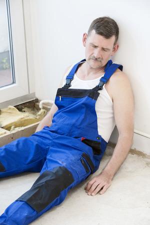 repairman lying on the floor and sleeping photo