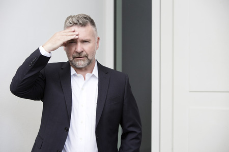 portrait of a businessman with a headache