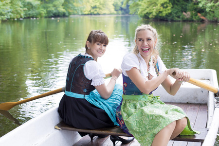 two woman with dirndl in a rowing boat photo