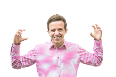 scare: young man in a red shirt smiles and holds up his arms to scare someone