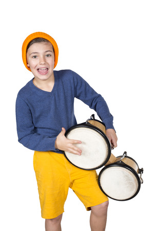 a young boy playing the drum