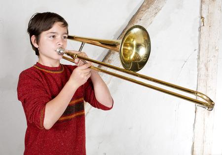 trombone: portrait of a boy playing the trombone