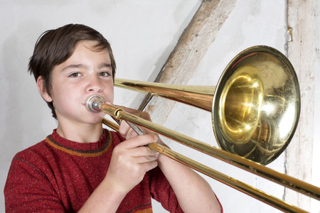 portrait of a boy playing the trombone photo