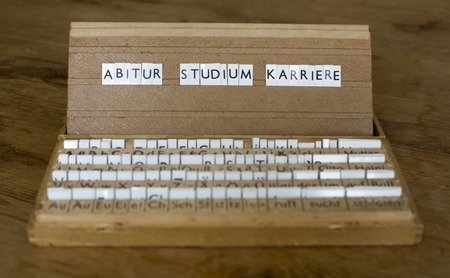 abi: a letterbox with the german words: Abitur Studium Karriere Stock Photo