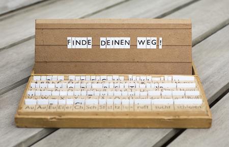 finde: a letterbox with the german text: \Finde Deinen Weg!\