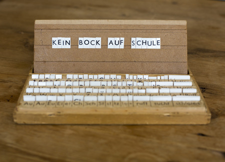 a letterbox with the german text: \Kein Bock auf Schule\ Stock Photo